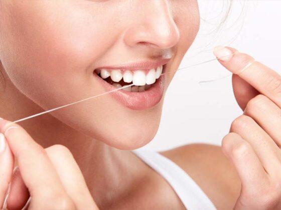 uso de la seda dental. clinica dental en aviles. dentistas en aviles